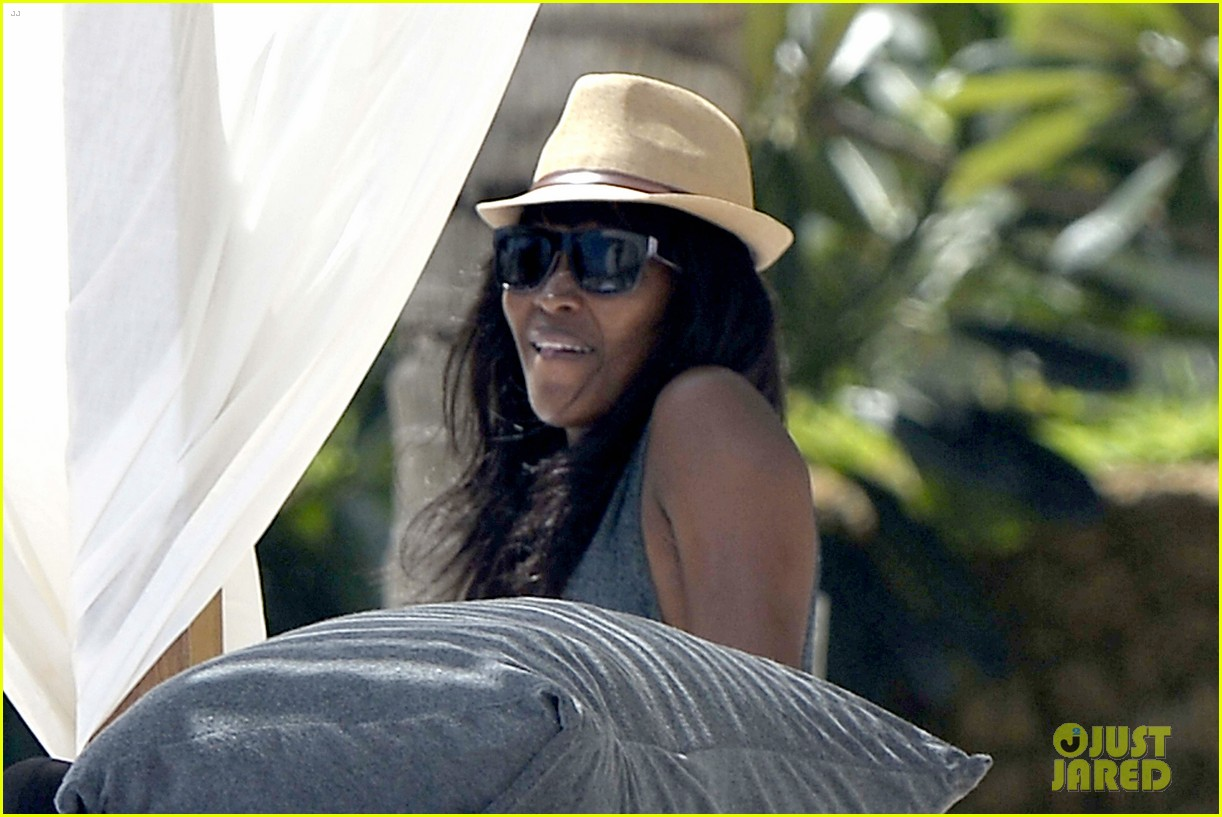 naomi campbell rocks a blue bikini at the beach in kenya 13
