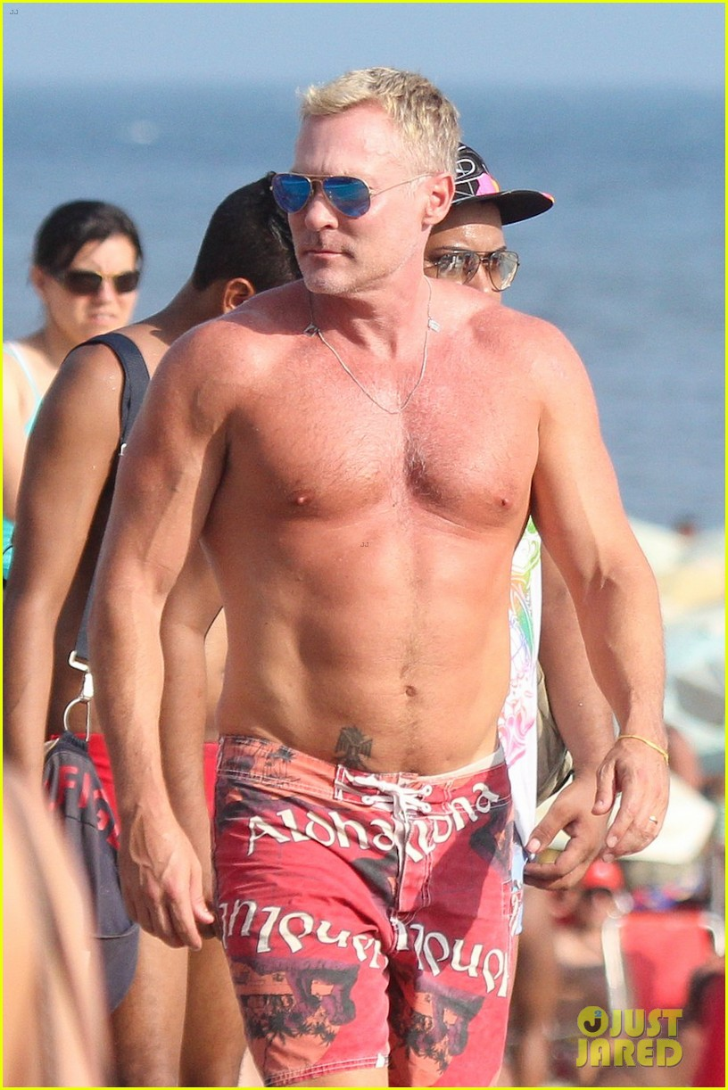 sam champion strips off board shorts to show speedo 023020021