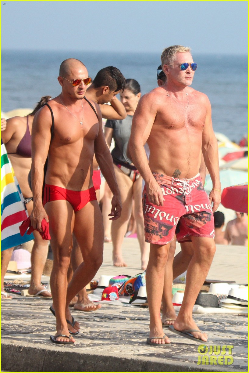 sam champion strips off board shorts to show speedo 073020026