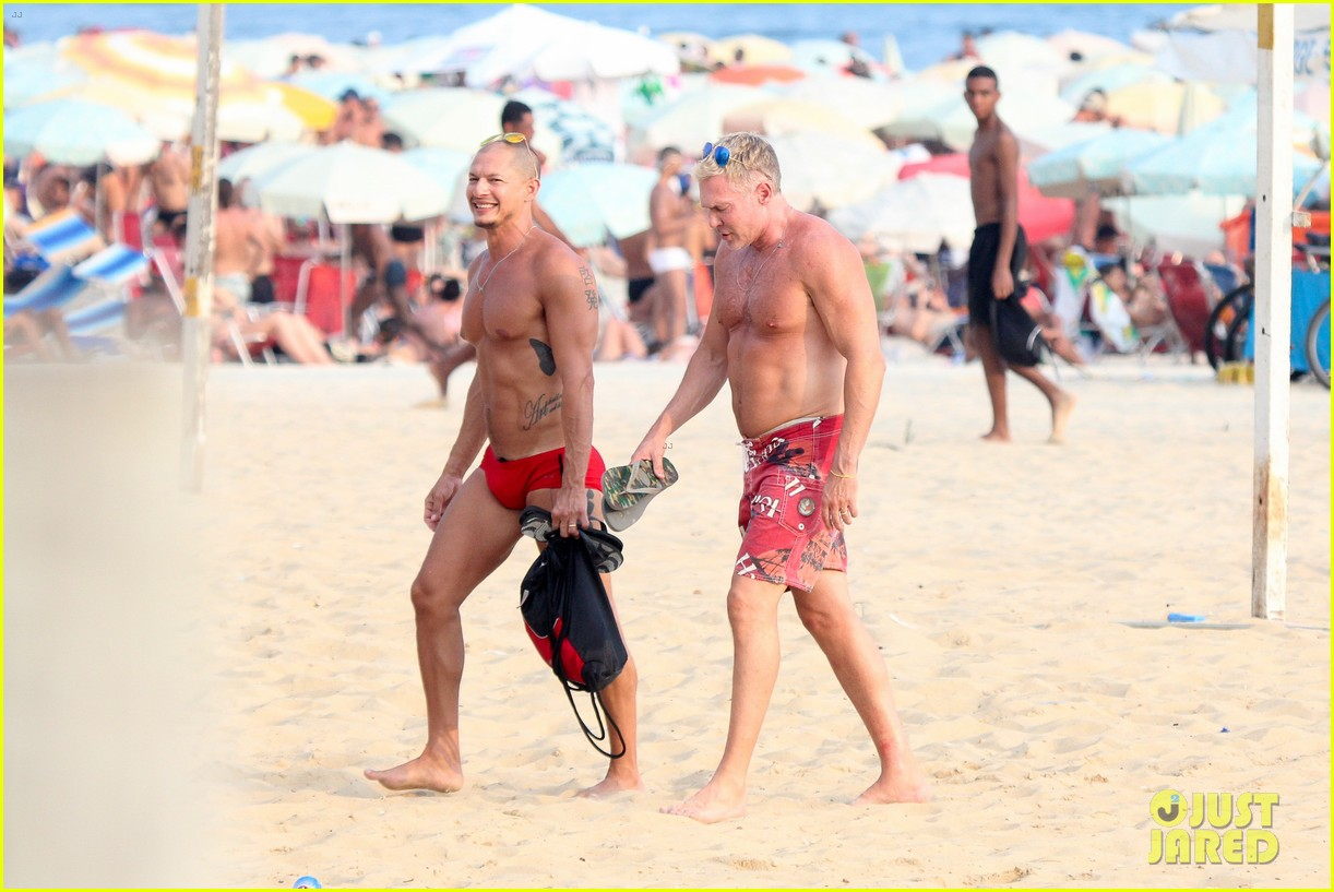 sam champion strips off board shorts to show speedo 10