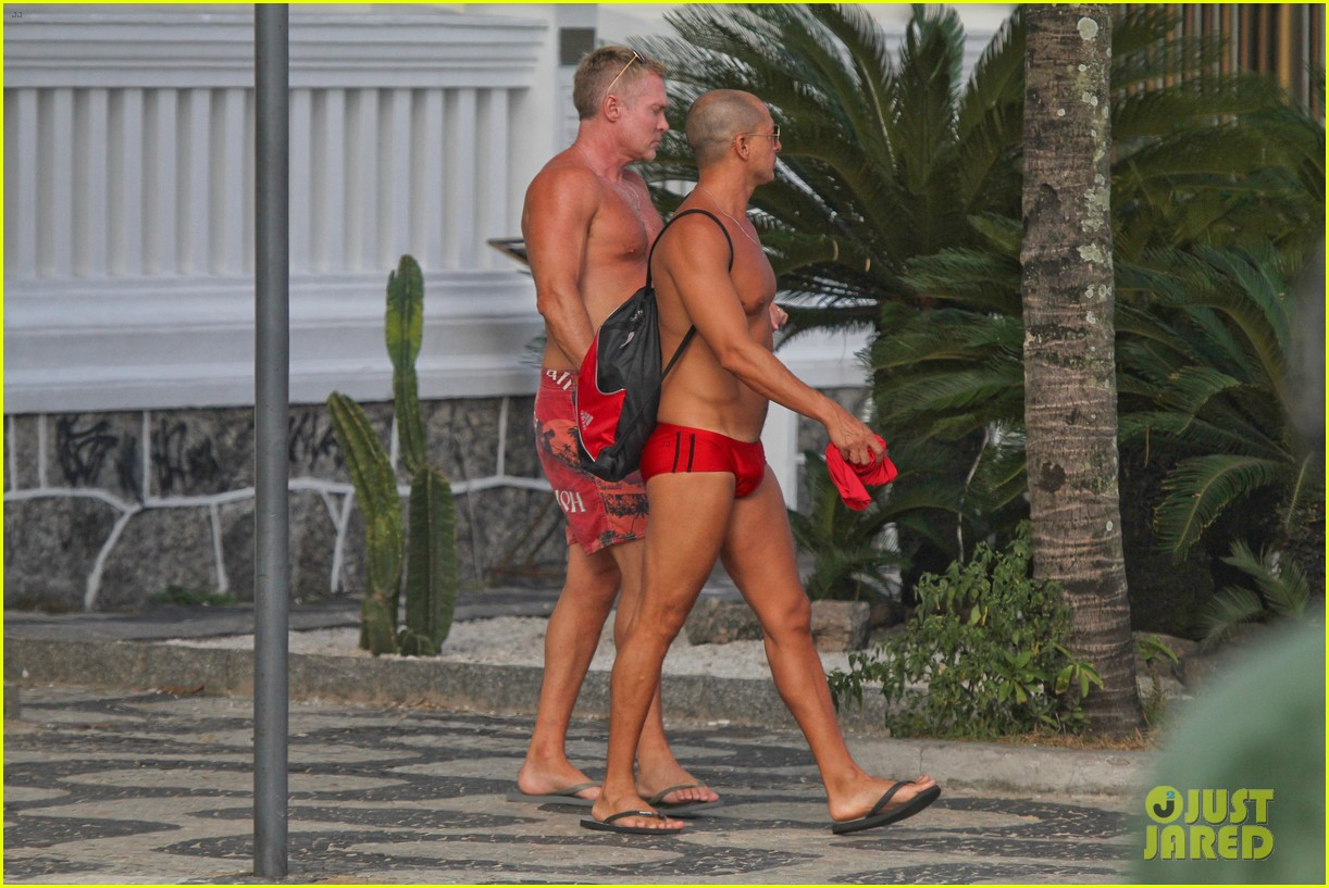 sam champion strips off board shorts to show speedo 143020033