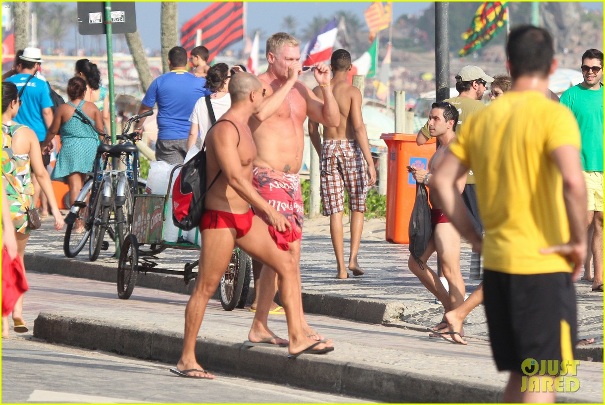 sam champion strips off board shorts to show speedo 153020034