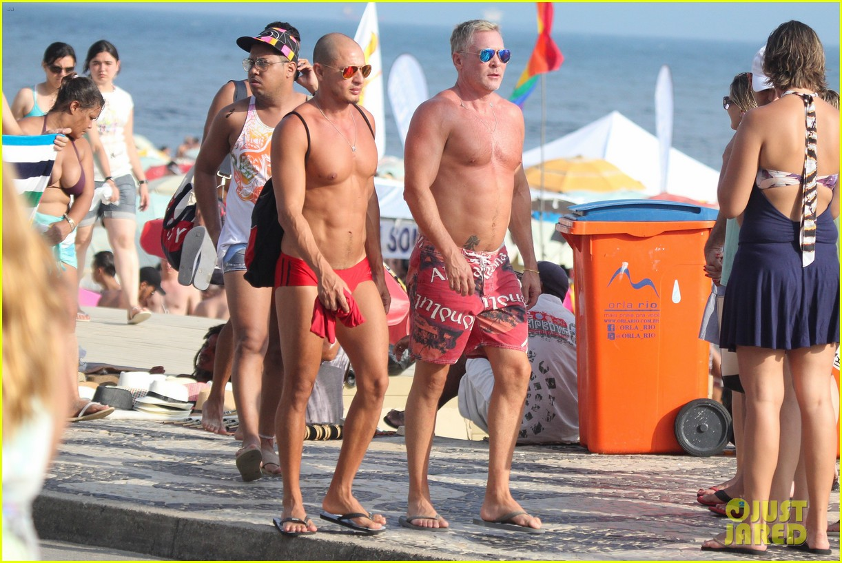 sam champion strips off board shorts to show speedo 19