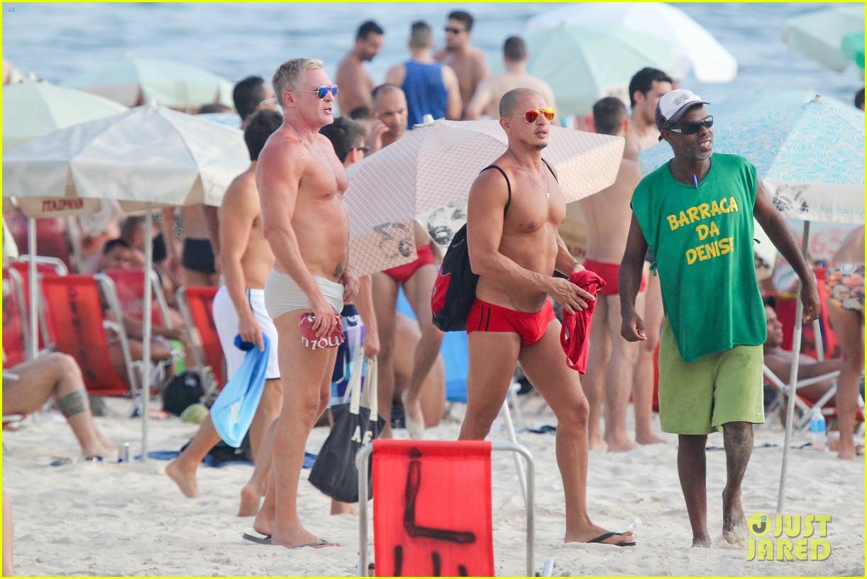 sam champion strips off board shorts to show speedo 233020042