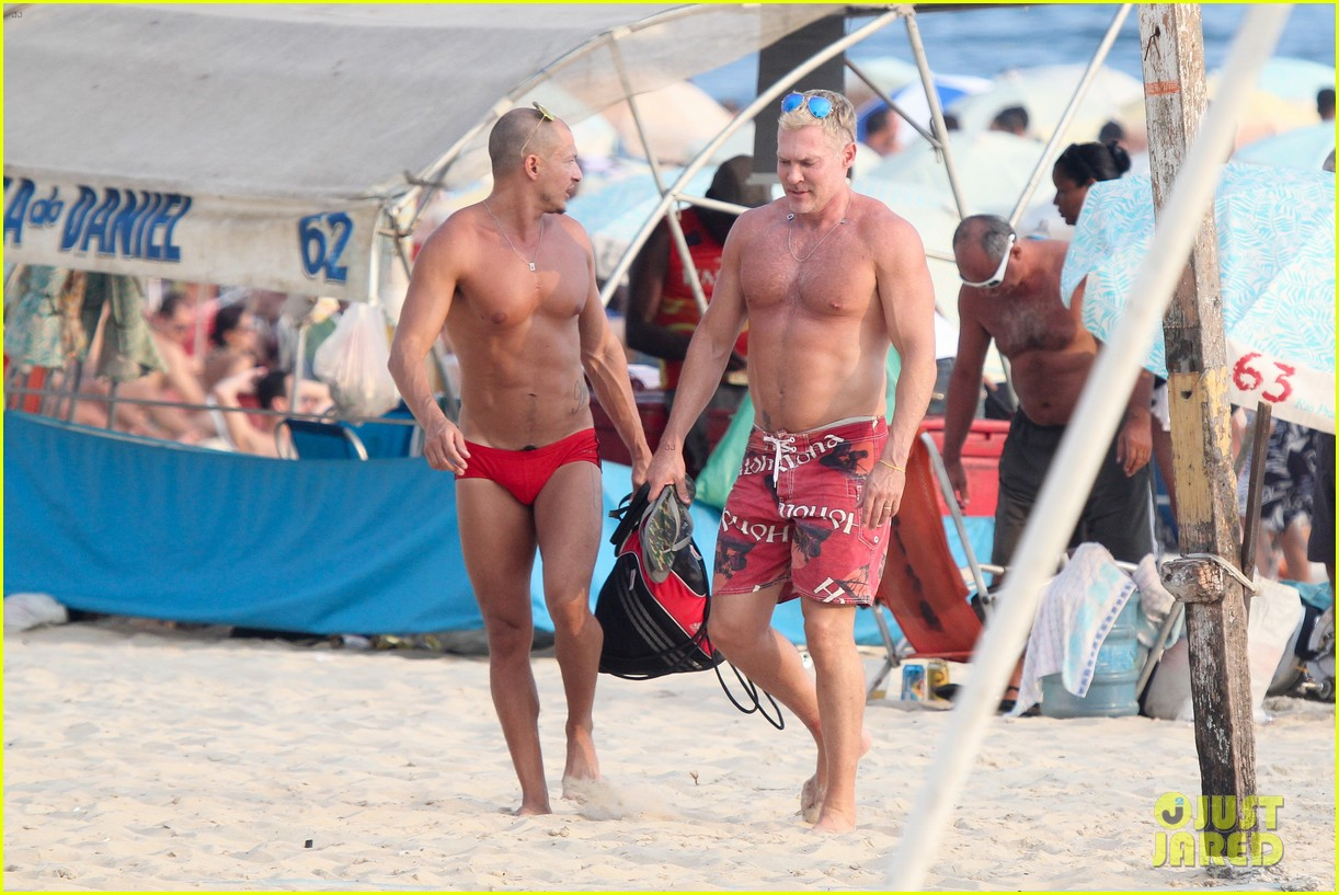 sam champion strips off board shorts to show speedo 243020043