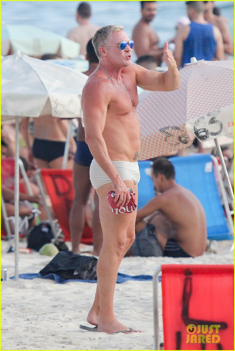 sam champion strips off board shorts to show speedo 253020044