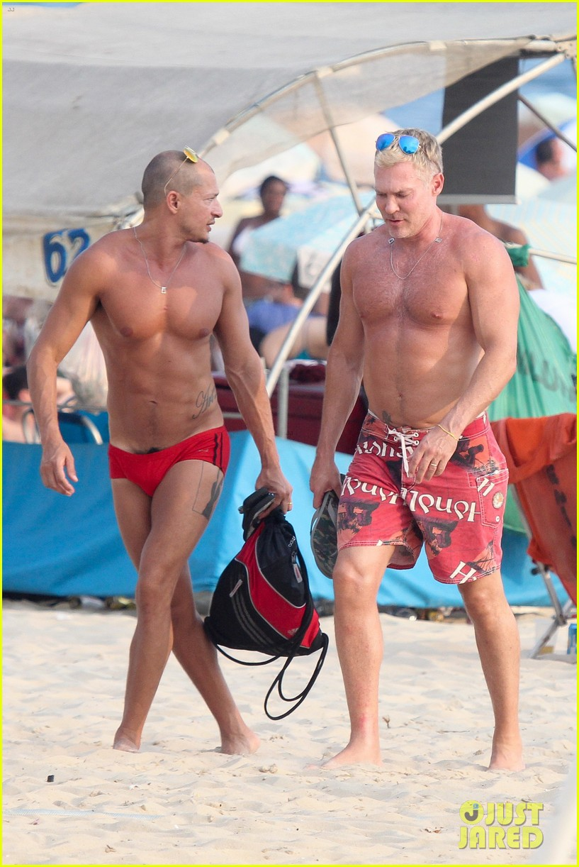 sam champion strips off board shorts to show speedo 263020045