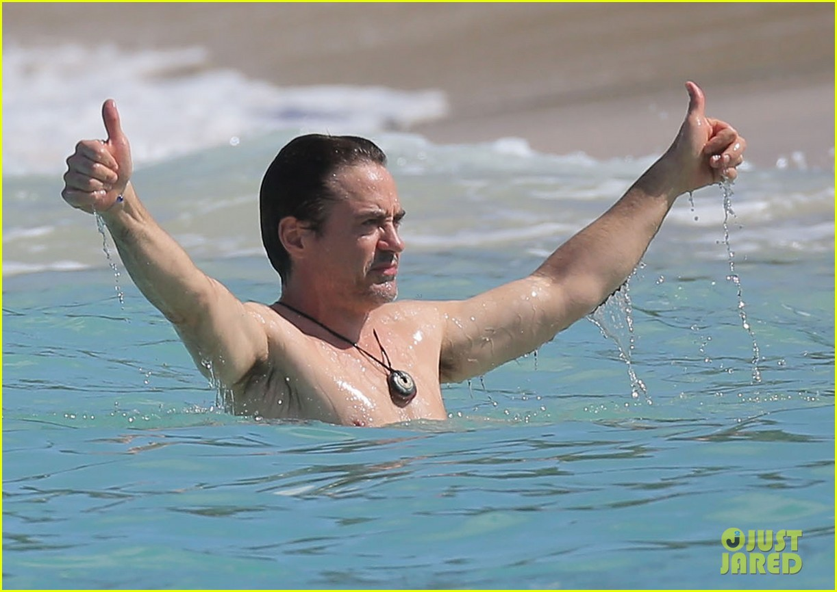 robert downey jr swims shirtless plays with exton in st barts 233019718