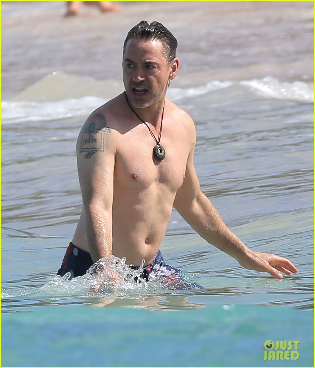 robert downey jr swims shirtless plays with exton in st barts 253019720
