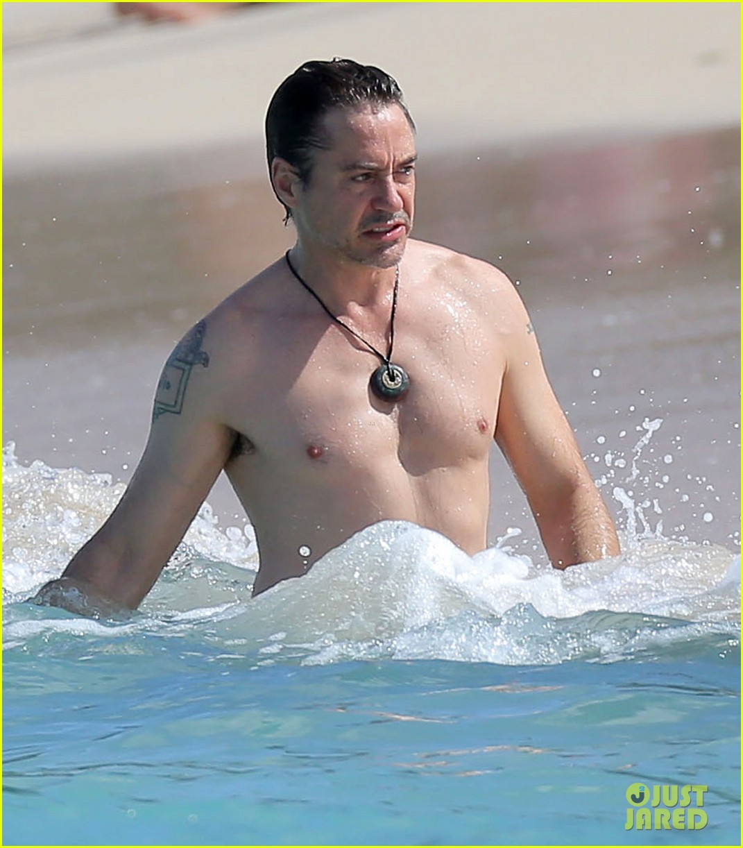 robert downey jr swims shirtless plays with exton in st barts 263019721