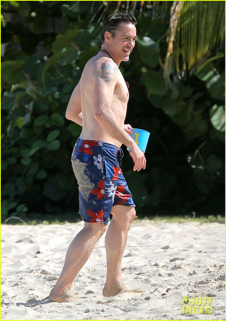 robert downey jr swims shirtless plays with exton in st barts 273019722