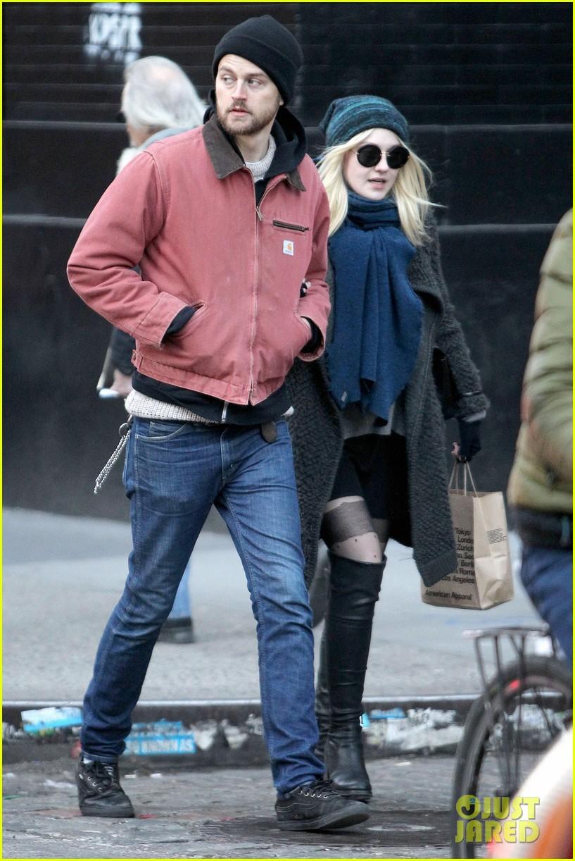 dakota fanning boyfriend jamie stratchan walk arm in arm in new york city 053010765