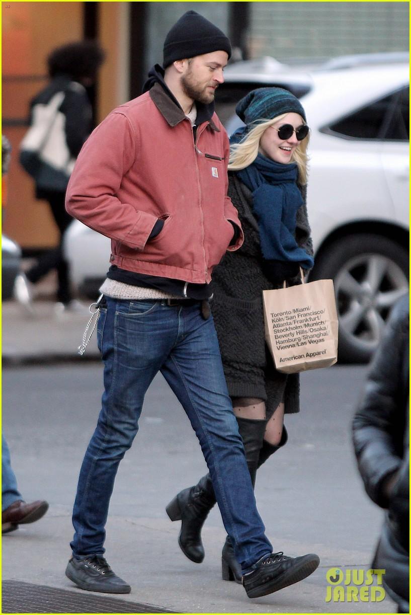 dakota fanning boyfriend jamie stratchan walk arm in arm in new york city 093010769