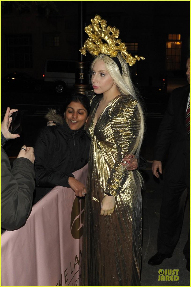 lady gaga rocks golden headpiece for artpop promo 09