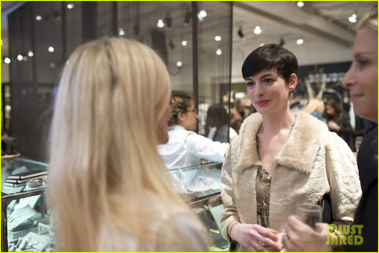 anne hathaway is a supportive wife at husband adam shulmans jewelry launch 023010772