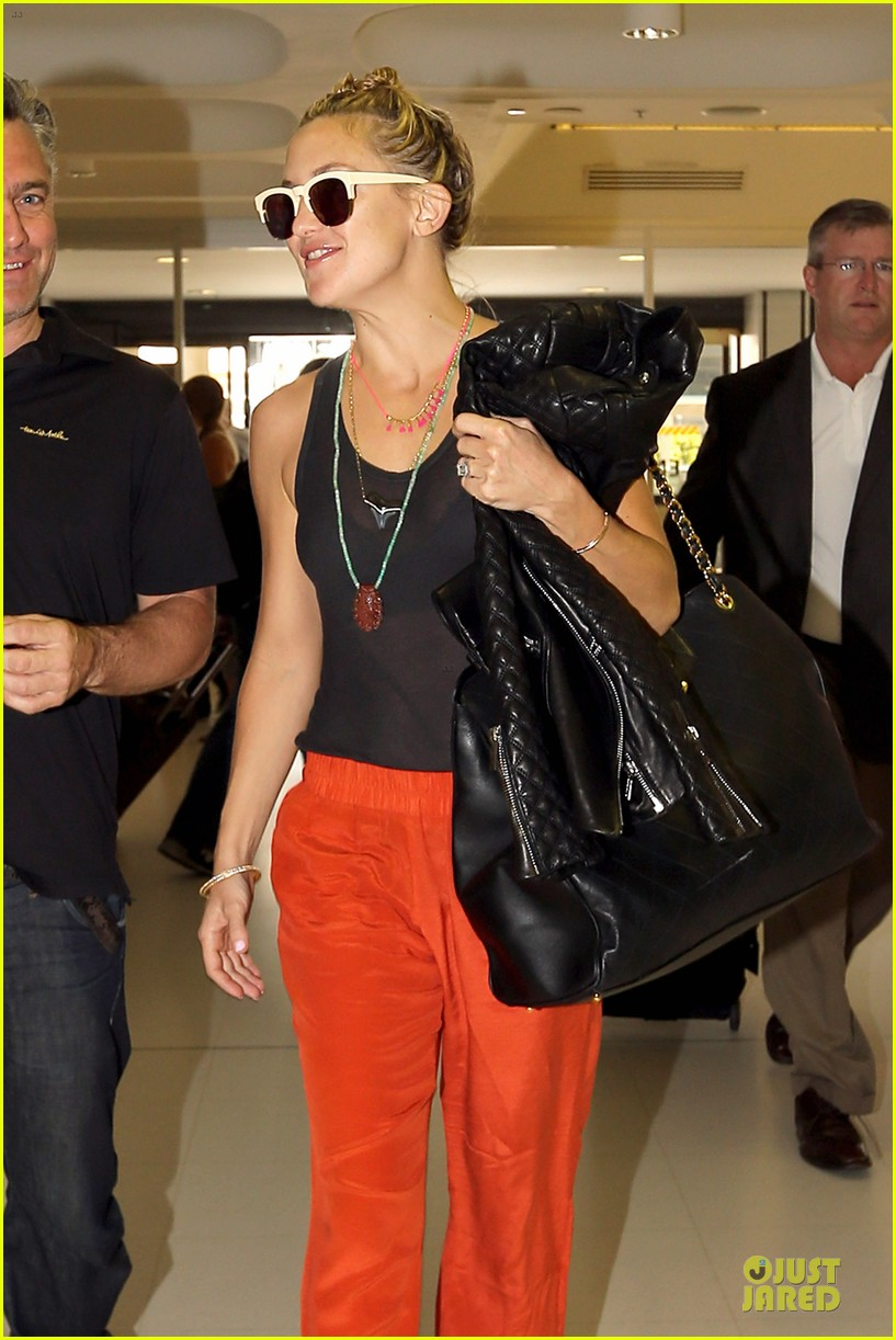 kate hudson bright orange sydney departure 04