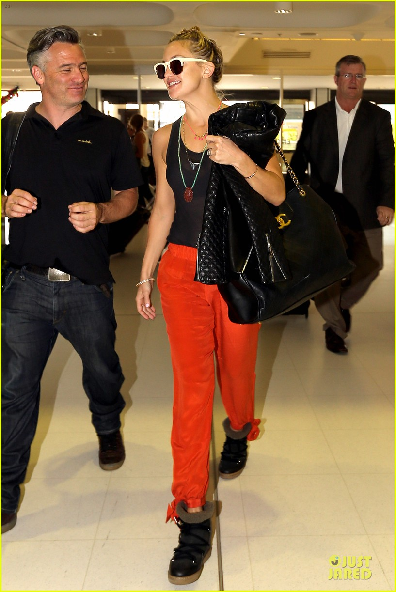 kate hudson bright orange sydney departure 103011868