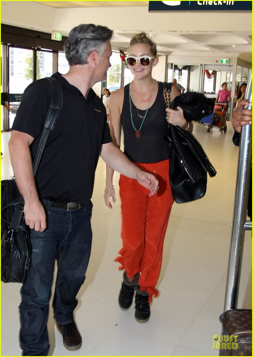 kate hudson bright orange sydney departure 143011872