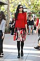 famke janssen is festive in red for last minute shopping 08