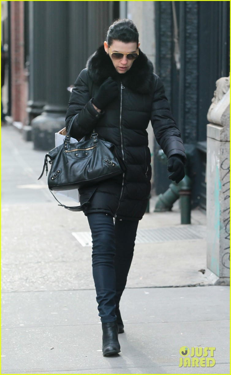 julianna margulies braves brisk weather for christmas eve walk 043017783