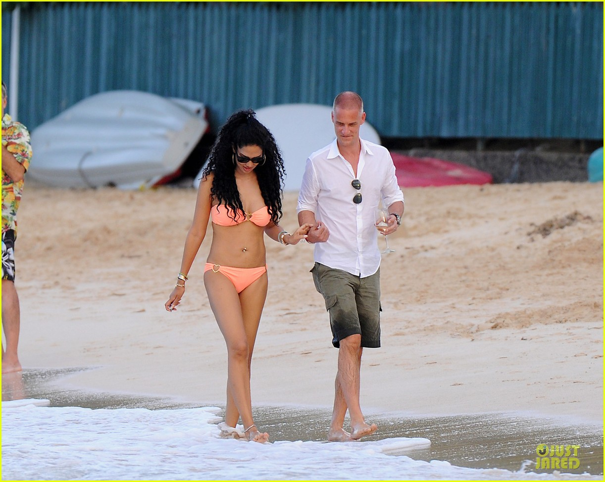 kimora lee simmons bright bikini babe with mystery man 043018576