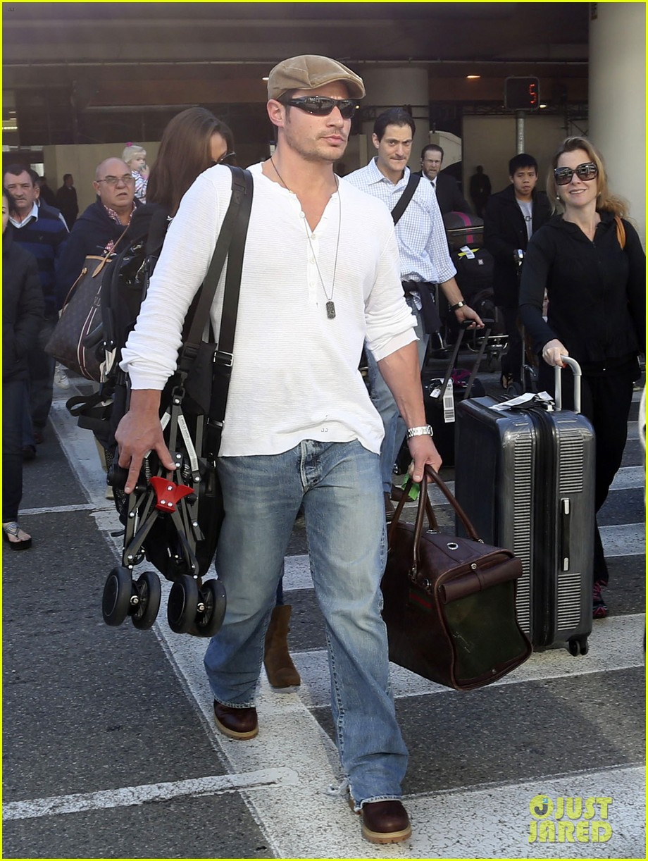 nick lachey wife vanessa lax arrival with son camden 063019326