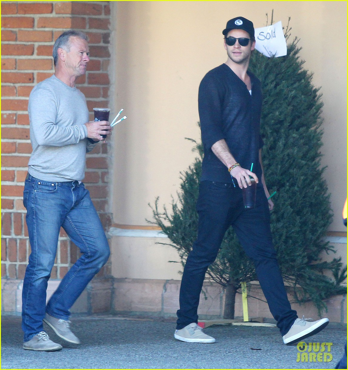 liam hemsworth grabs coffee groceries with dad craig 03