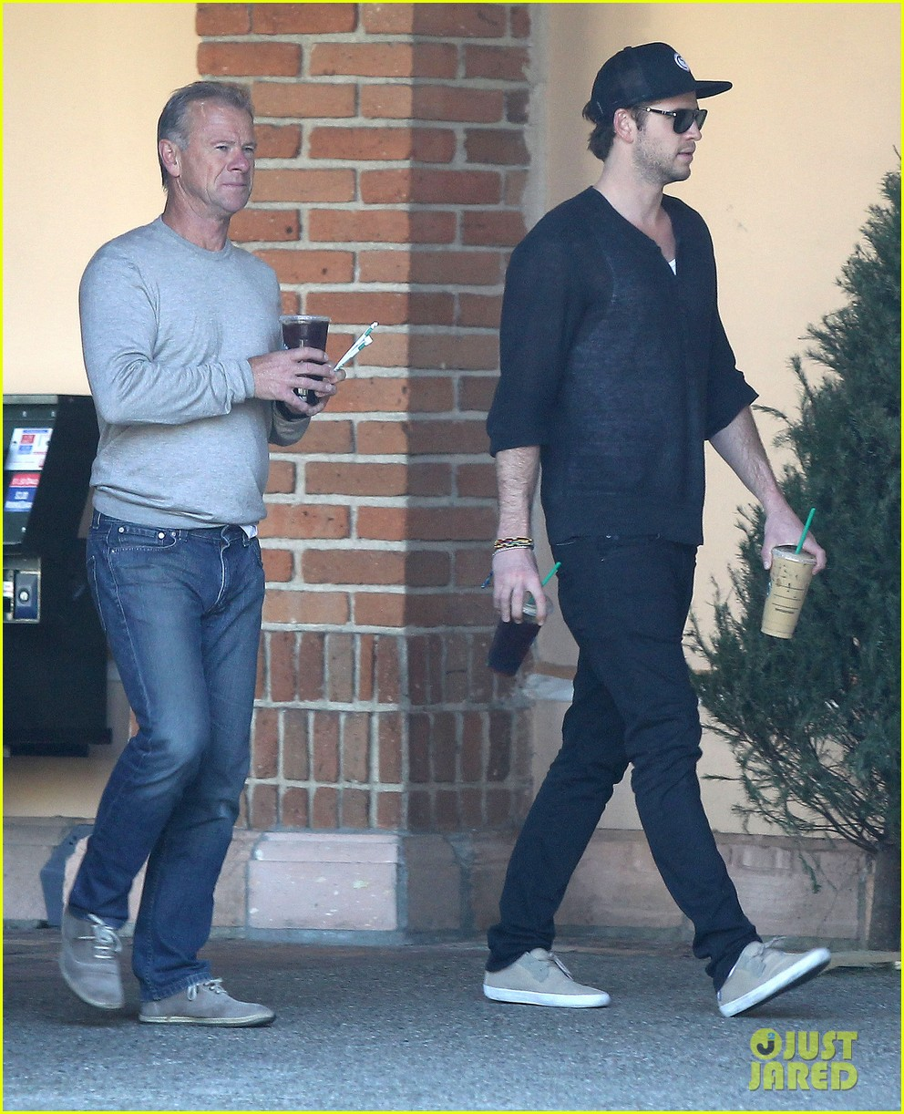 liam hemsworth grabs coffee groceries with dad craig 06