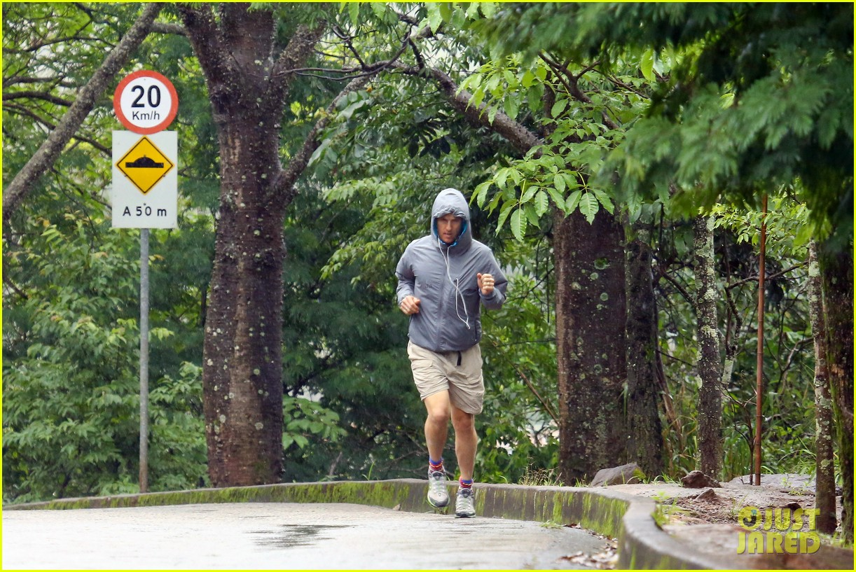 matthew mcconaughey braves the rain for a run in brazil 273018383