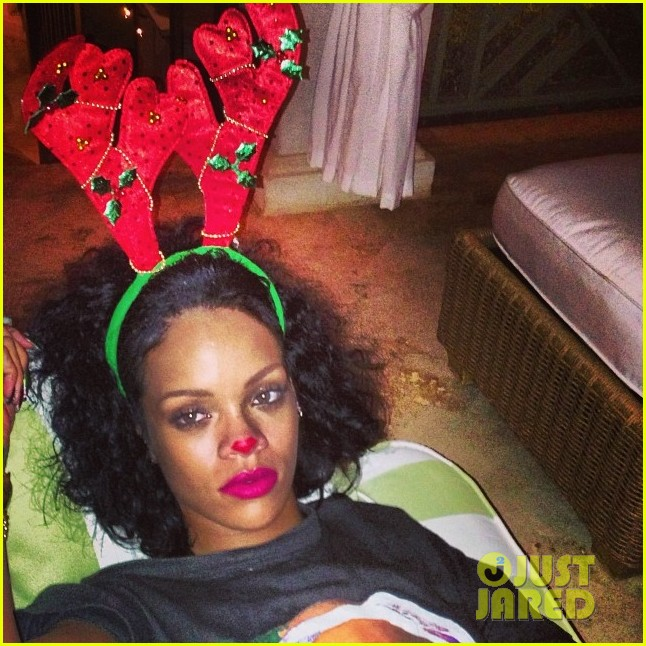 rihanna is a red nosed reindeer at her christmas eve party 043017569