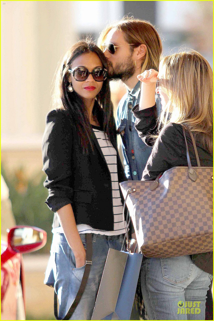 zoe saldana adoring kiss from marco perego at barneys 02