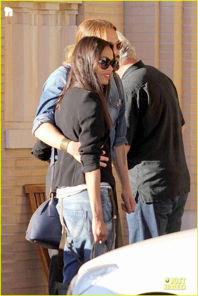 zoe saldana adoring kiss from marco perego at barneys 043016872