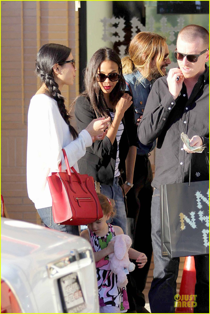 zoe saldana adoring kiss from marco perego at barneys 09