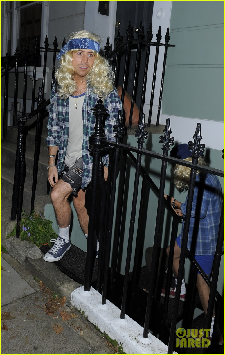 harry styles wears blonde wig elephant head at nightclub 18