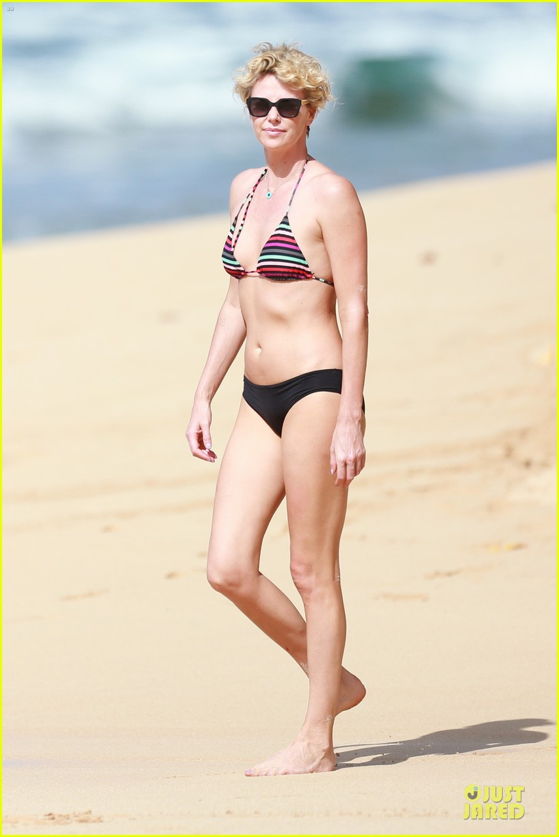 charlize theron colorful hawaiian bikini babe 063020230