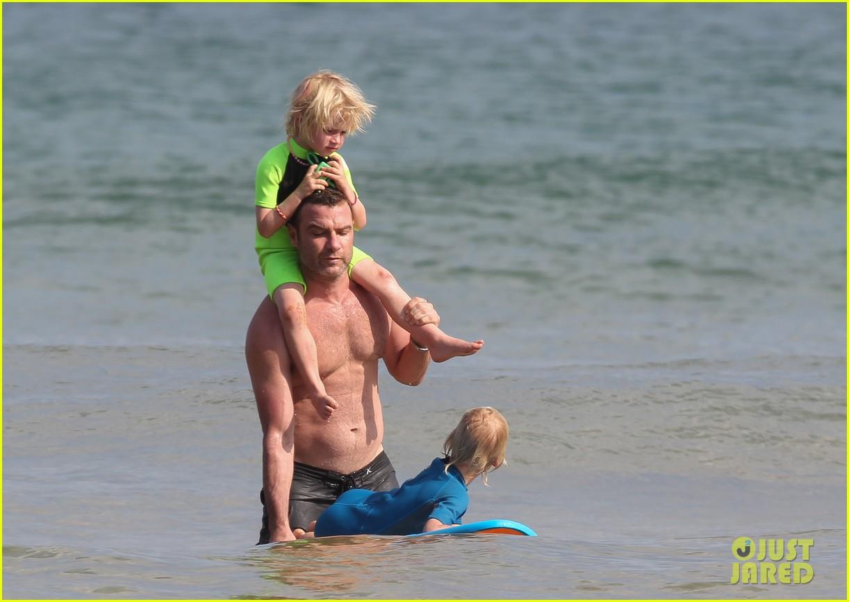 naomi watts sunbathes liev schreiber swims shirtless 023015391