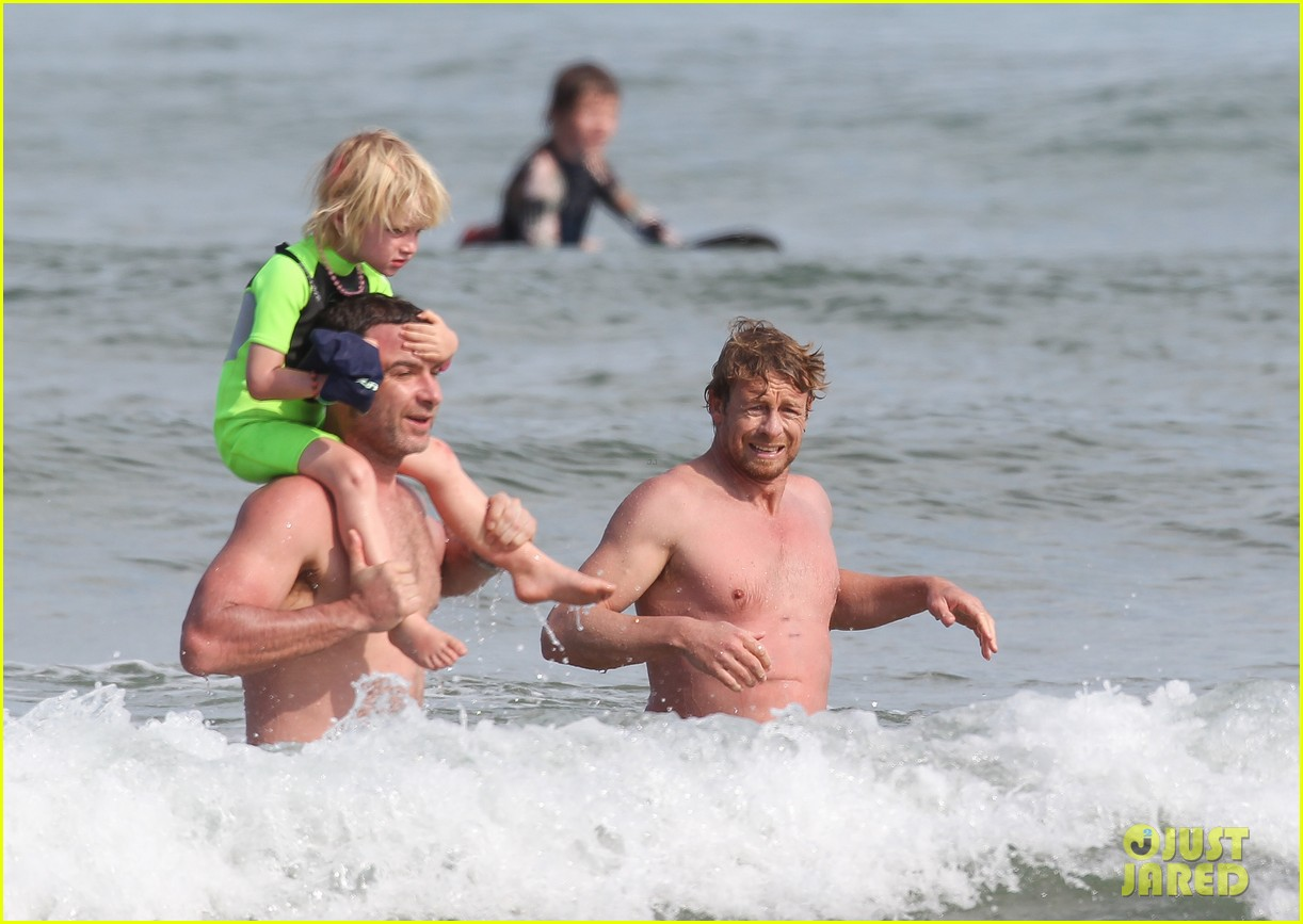 naomi watts sunbathes liev schreiber swims shirtless 043015393