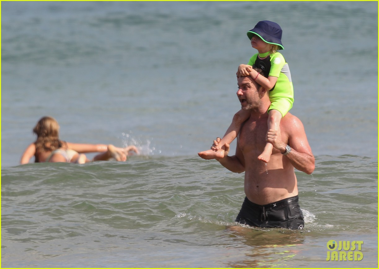naomi watts sunbathes liev schreiber swims shirtless 153015404