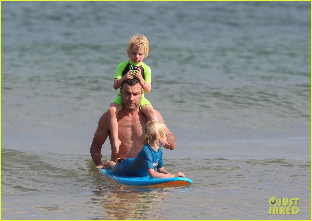 naomi watts sunbathes liev schreiber swims shirtless 163015405