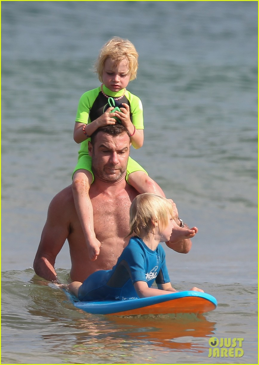 naomi watts sunbathes liev schreiber swims shirtless 173015406