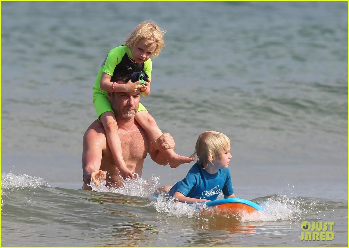 naomi watts sunbathes liev schreiber swims shirtless 183015407