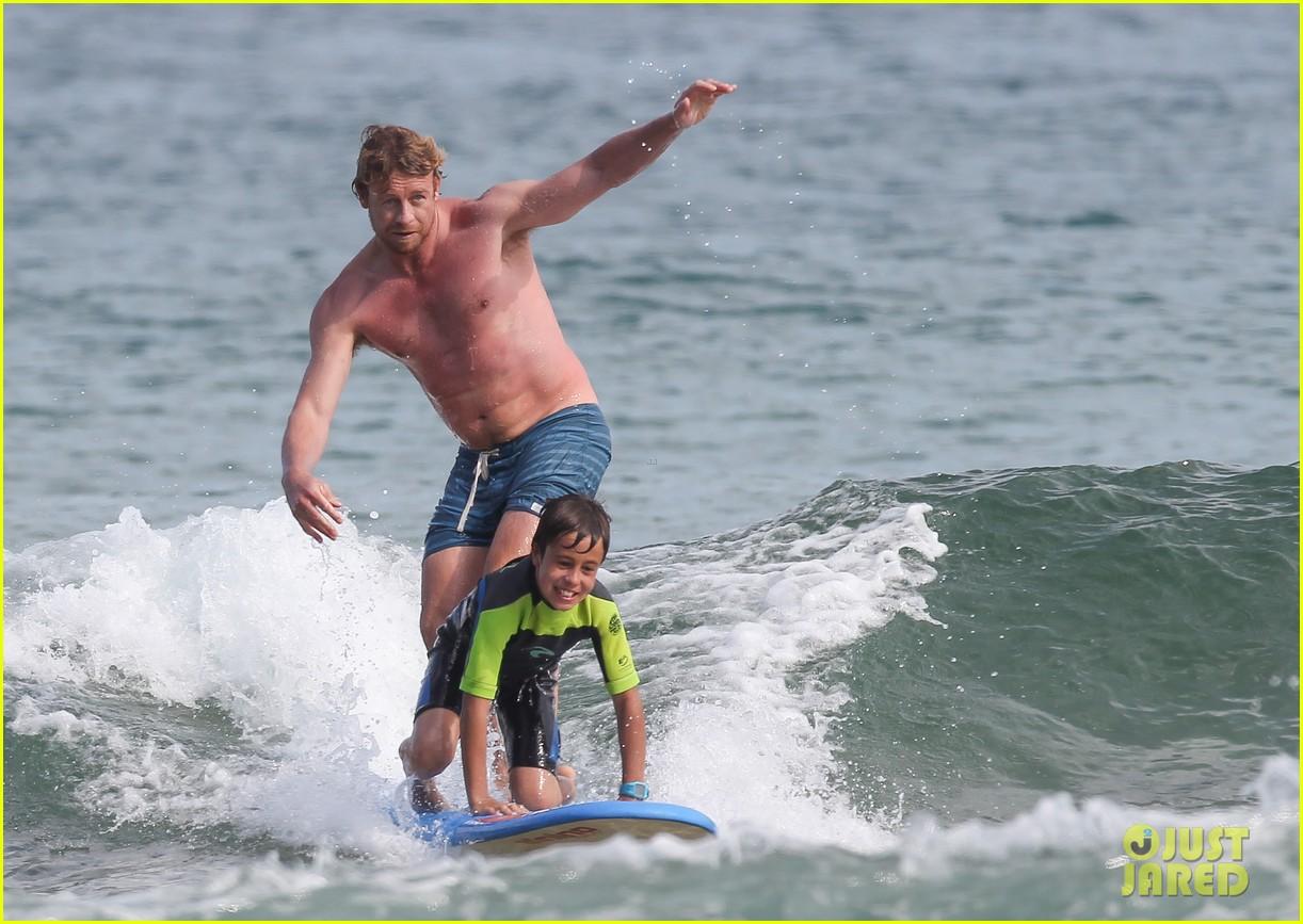naomi watts sunbathes liev schreiber swims shirtless 223015411