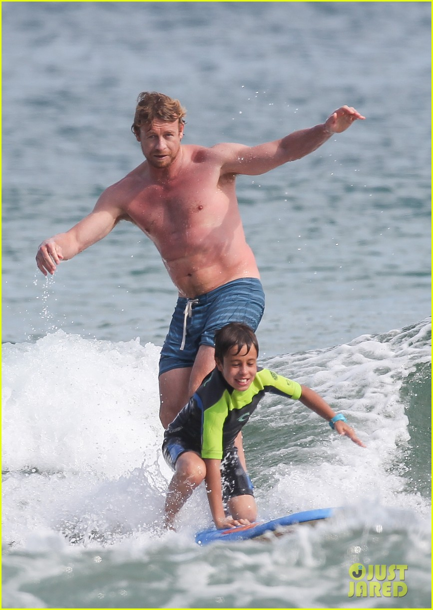 naomi watts sunbathes liev schreiber swims shirtless 233015412