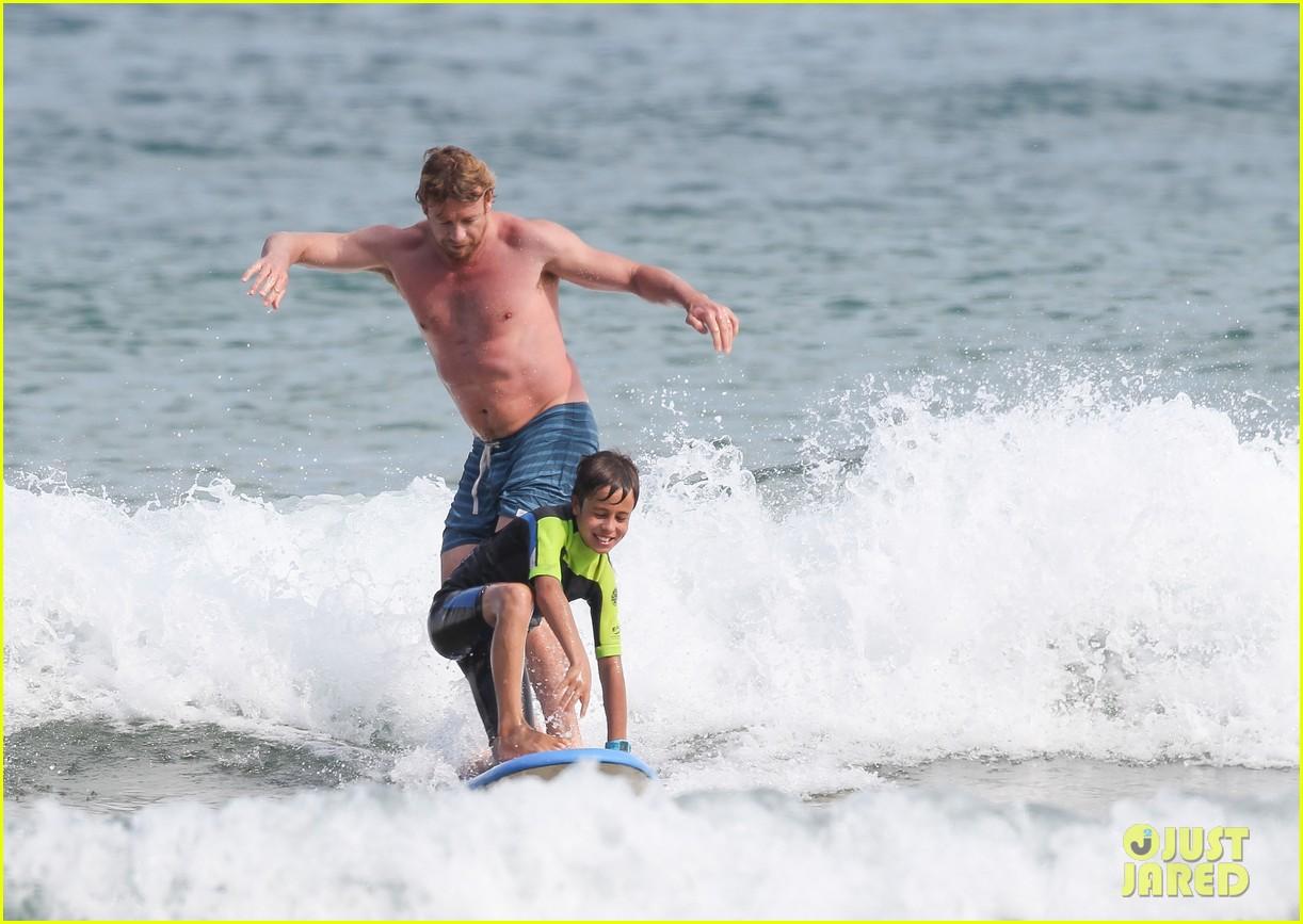 naomi watts sunbathes liev schreiber swims shirtless 243015413