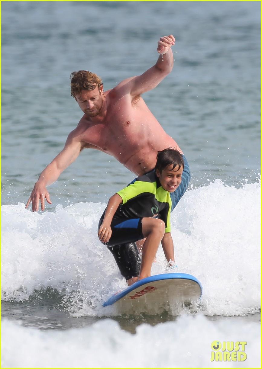 naomi watts sunbathes liev schreiber swims shirtless 253015414