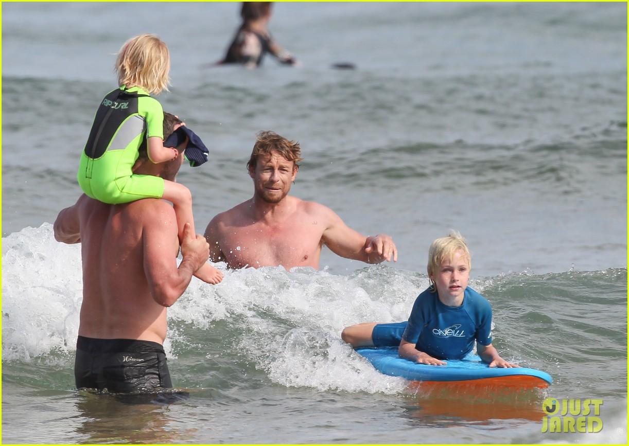 naomi watts sunbathes liev schreiber swims shirtless 31