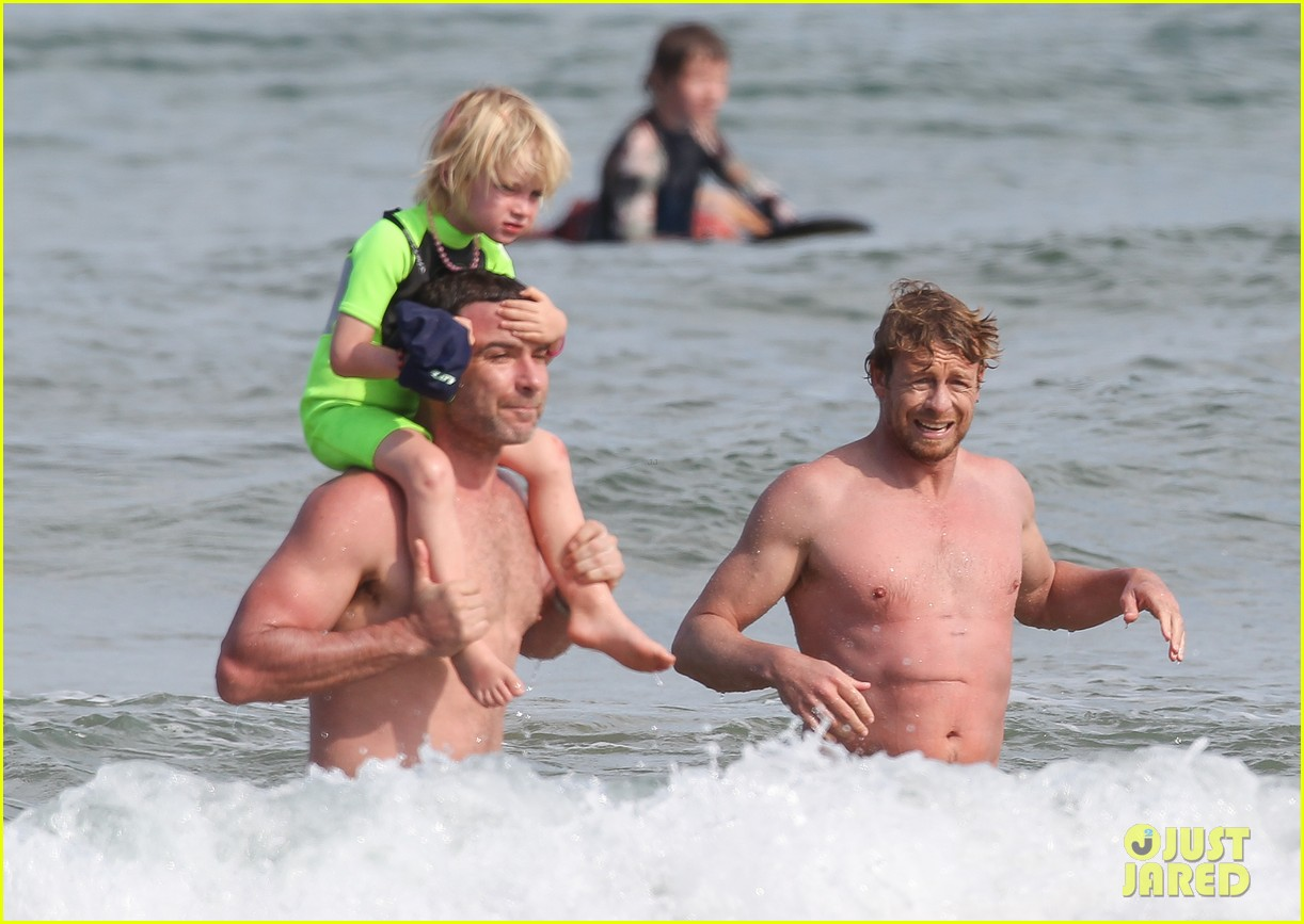 naomi watts sunbathes liev schreiber swims shirtless 323015421