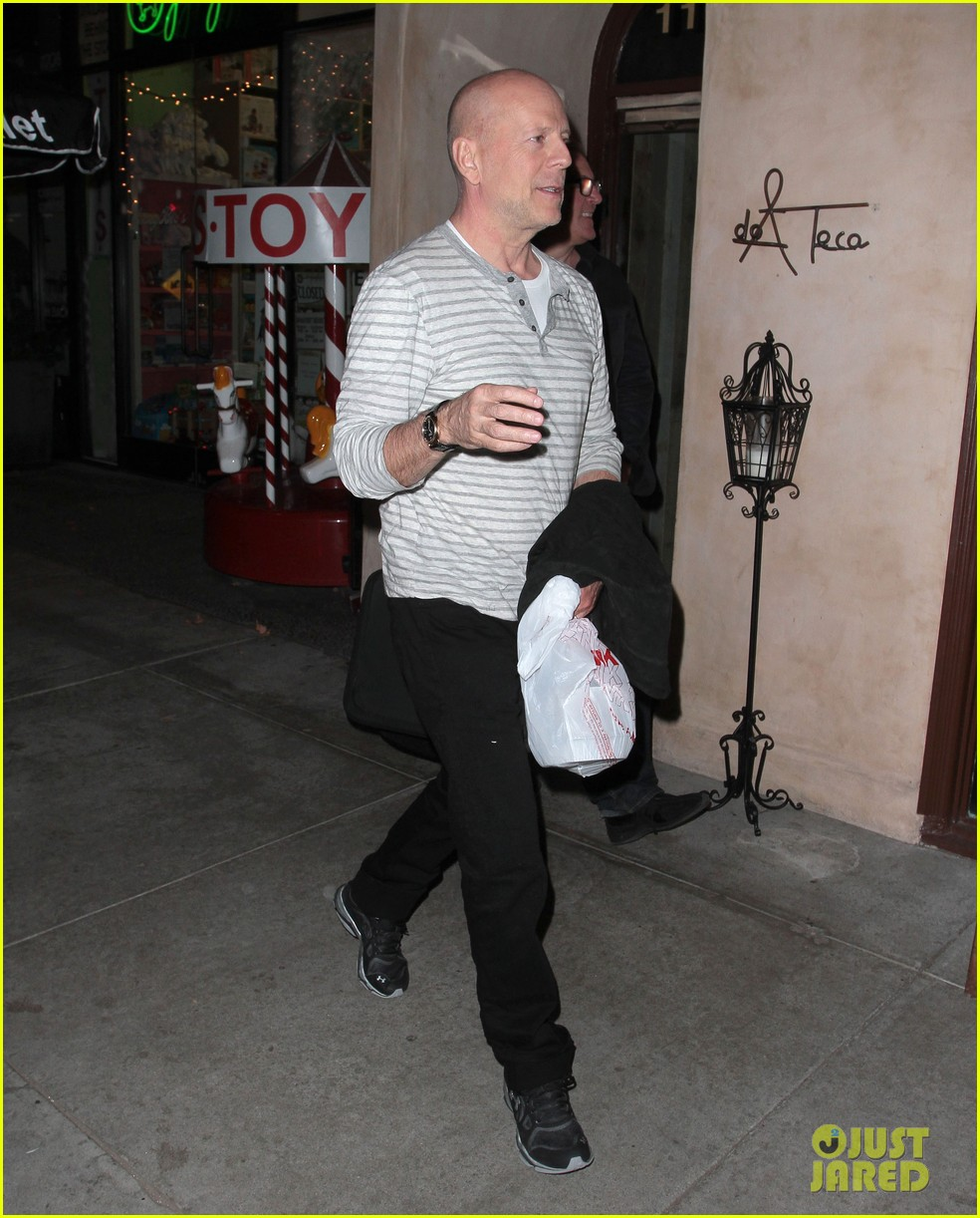 bruce willis dines with red producer after baby news 033014920