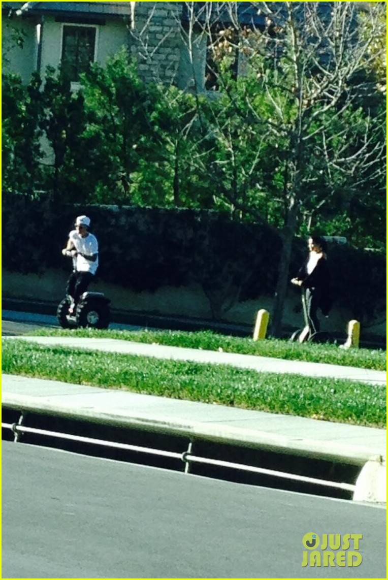 justin bieber selena gomez ride segways together photo 013021650