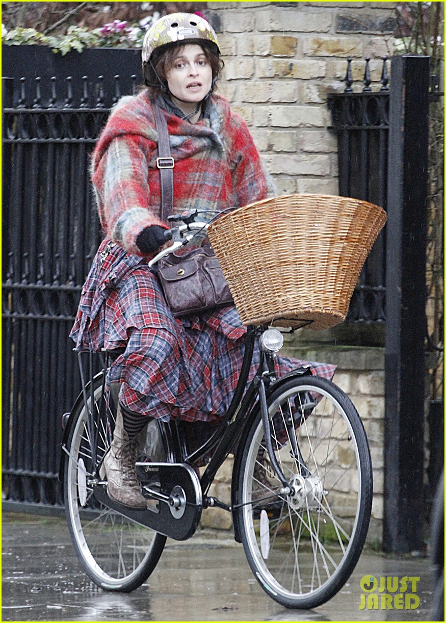 helena bonham carter bikes in the rain with son billy 023022105